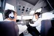 Pilots flying airplane