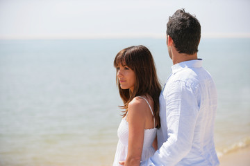 Young couple wearing white at the beach