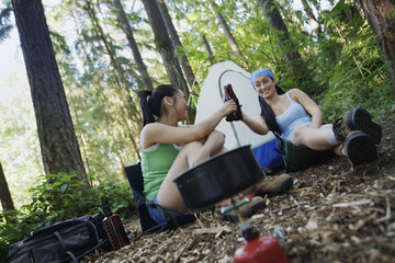 Women relaxing at campsite