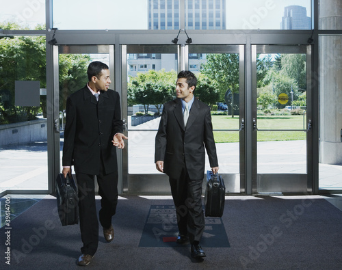 Businessmen entering building