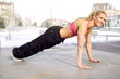 Beautiful happy fitness woman exercising