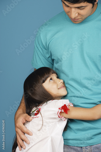 Young girl looking up at young man