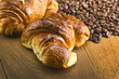 croissant and fresh coffee beans