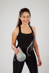 Woman in exercise outfit smiling