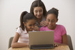 Three girls with laptop computer
