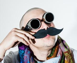 Man fiddles his false moustache