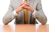 Businessman Elbows on Desk Hands Folded