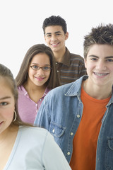 Portrait of four teenagers smiling