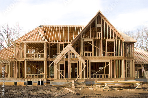 McMansion type house under construction in framing phase - 39617323