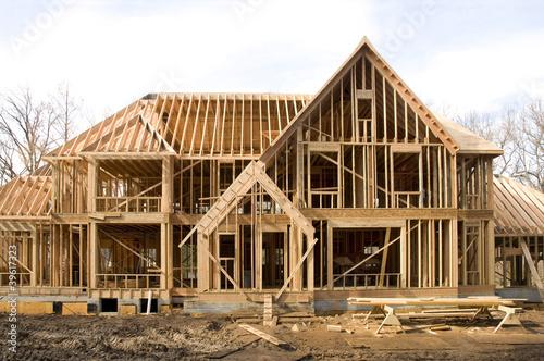 Leinwanddruck Bild McMansion type house under construction in framing phase