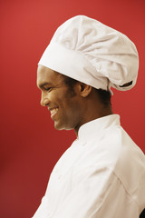 Side view of male chef wearing hat