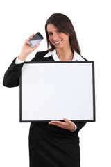Businesswoman showing phone