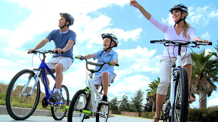 Caucasian Parents and Son Outdoors Cycling