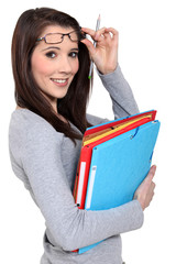 Woman with glasses and folders