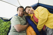 Portrait of couple laying in tent