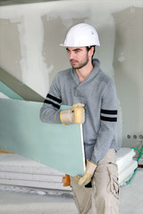 Man carrying plaster-board