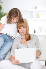 Mother and daughter with laptop