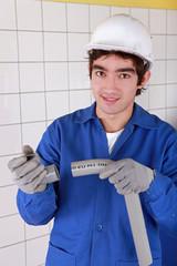portrait of young apprentice handling u turn