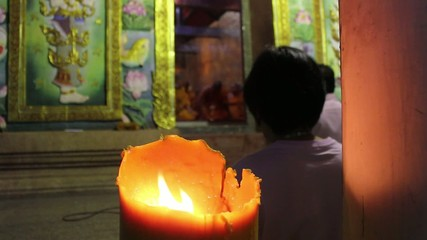 candlelight in buddhism worship
