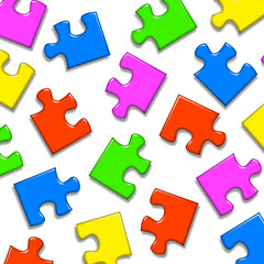 Colored puzzle pieces on white background