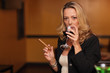 Woman drinking wine and smoking a cigar