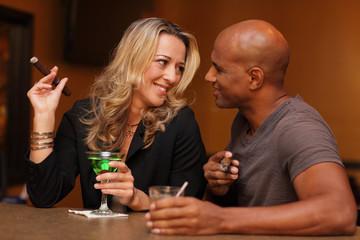 Man and woman smoking and drinking at the bar