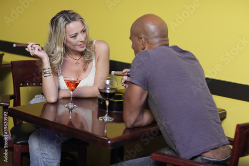 Mature couple sitting and drinking