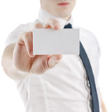 young business man holding and showing blank card