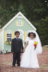 Boy and girl at pretend wedding