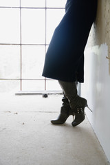 Woman in high heeled boots