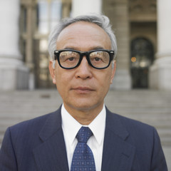 Senior Asian businessman posing