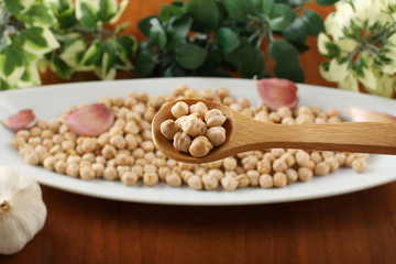 Raw chickpeas on spoon