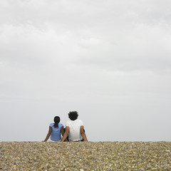 Couple sitting together at beach
