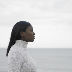 Young woman's profile with ocean in the background