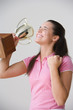 Portrait of excited teenage girl with trophy
