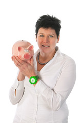 Woman is holding piggy bank