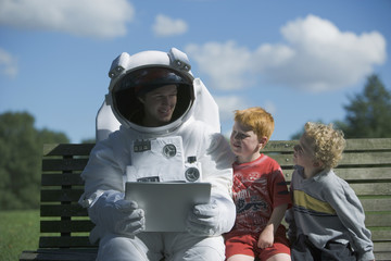 Astronaut talking to children