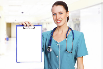 Female doctor with the blank paper on clipboard
