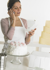 Female baker talking on her cell phone