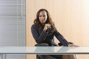 Businesswoman sitting behind an empty desk