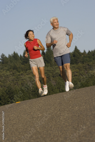 Senior couple jogging together
