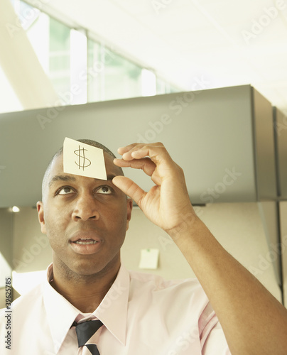 Businessman wearing a question mark on his forehead
