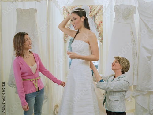 Young bride-to-be trying on her gown