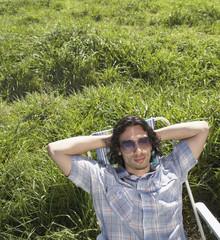 Man relaxing in green meadow