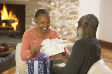 Senior African couple opening presents