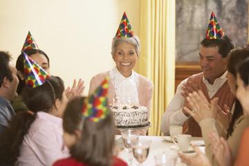 Family birthday party for Hispanic grandmother