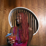 Young African woman having a drink