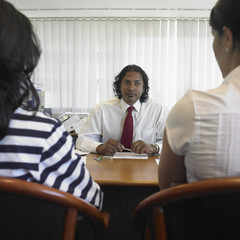 Indian businessman talking to clients