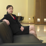 Asian businesswoman sitting in lobby