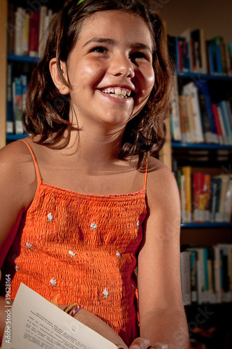 Young girl laughing in a library